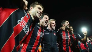 BOURNEMOUTH, ENGLAND - APRIL 27:  (L-R) Brett Pitman, Yann Kermorgant, Eddie Howe manager of Bournemouth, Andrew Surman and Callum Wilson of Bournemouth celebrate victory on the pitch after the Sky Bet Championship match between AFC Bournemouth and Bolton Wanderers at Goldsands Stadium on April 27, 2015 in Bournemouth, England. Bournemouth's 3-0 victory puts them on the brink of promotion to the Barclays Premier League.  (Photo by Clive Rose/Getty Images)